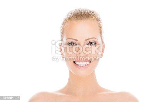 673361134 istock photo Beautiful woman showing healthy white teeth 516654125