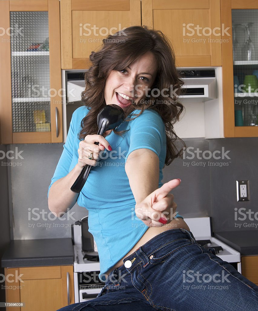 Beautiful Woman Singing Into A Spoon In The Kitchen Stock Photo ...