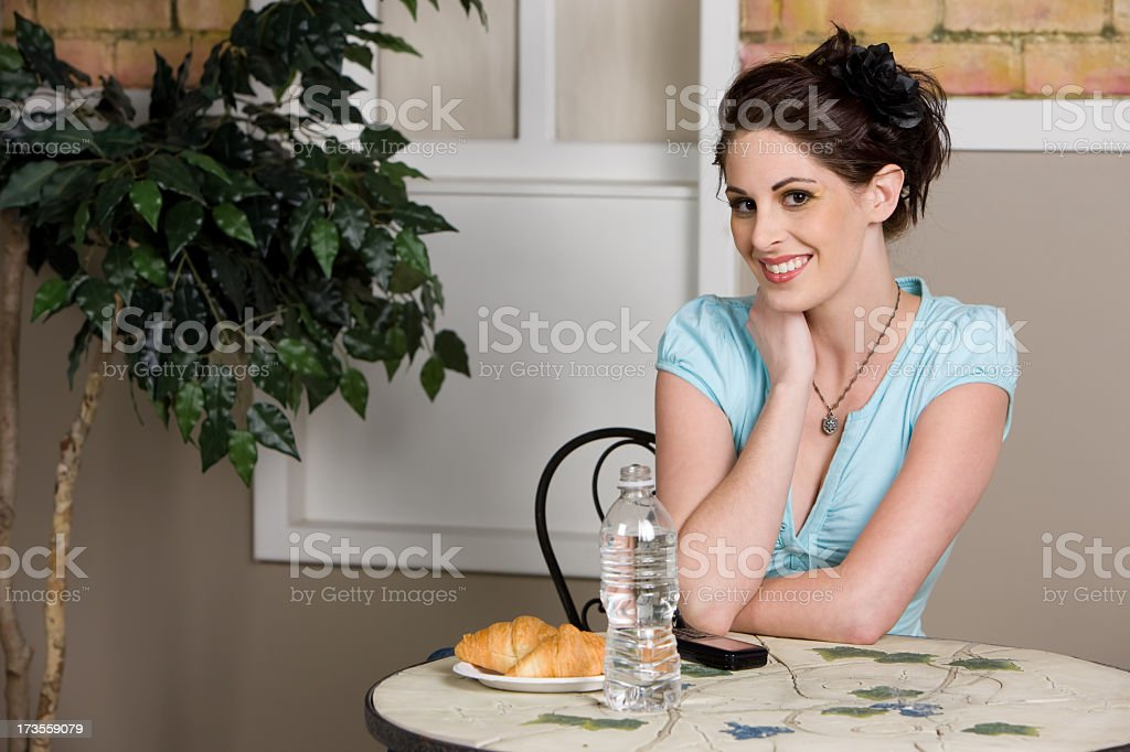 Beautiful Woman Sitting at Cafe Table royalty-free stock photo