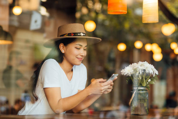 Beautiful woman sitting in a cafe stock photo