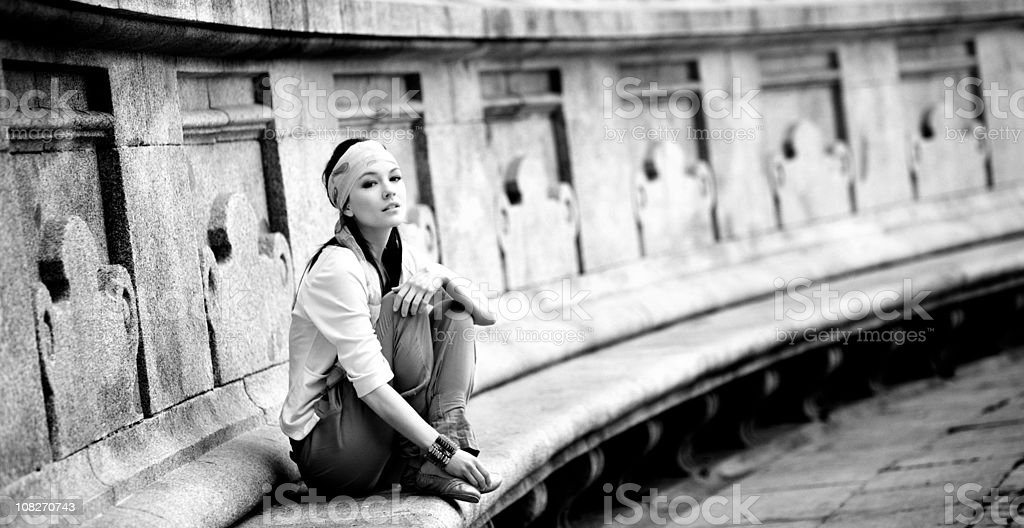 Beautiful woman sitting in Retiro Park, Madrid royalty-free stock photo
