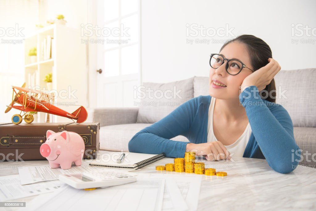 beautiful woman sitting in the living room stock photo