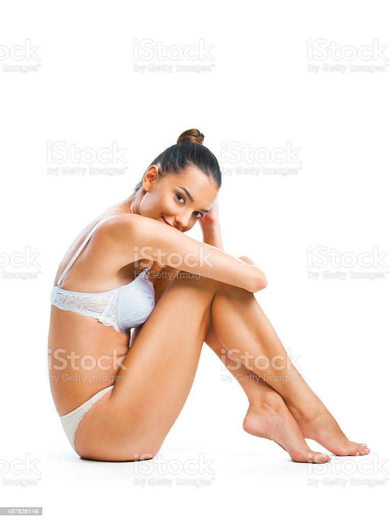Beautiful woman sitting, isolated on white background stock photo