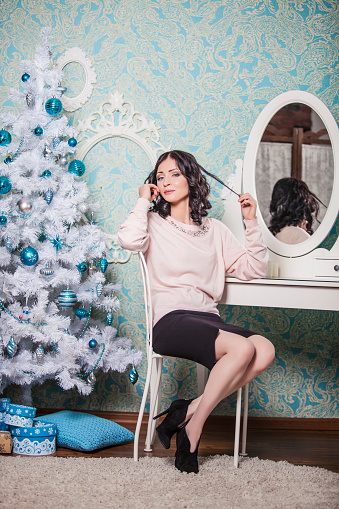 578573556 istock photo Beautiful woman sitting on a chair in the new year 497807668