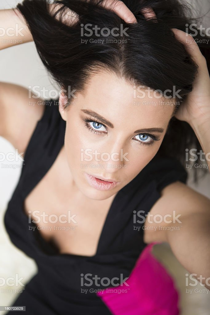 Beautiful woman sitting on floor royalty-free stock photo