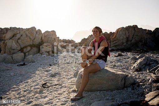 670374358 istock photo Beautiful woman sitting on the rocks 901114728