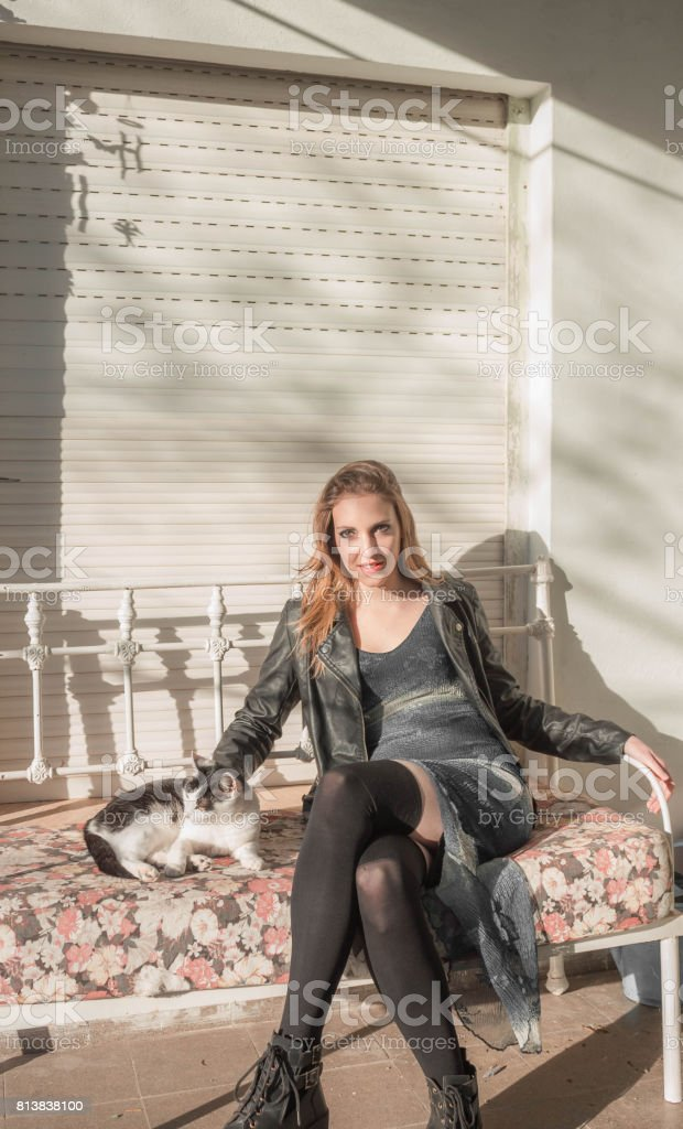 Beautiful woman sitting with kitten stock photo