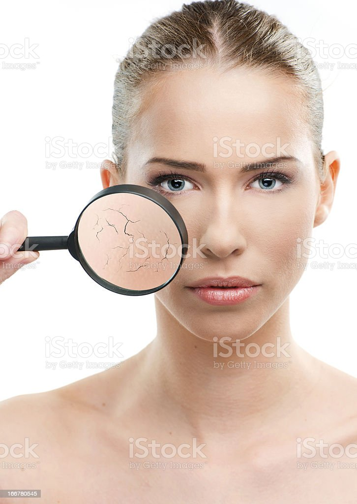 Beautiful woman, skin close up with a magnifying glass stock photo