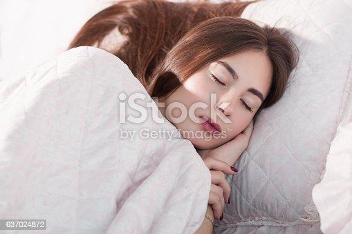 istock Beautiful woman sleeping in bed close-up 637024872