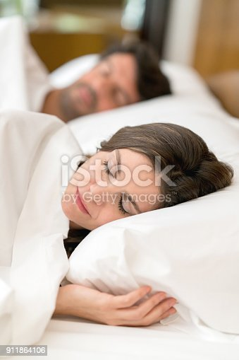 istock Beautiful woman sleeping in bed very tranquil 911864106