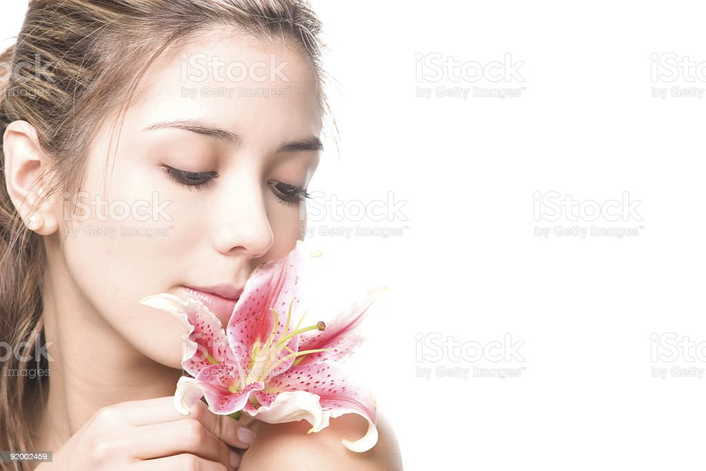 beautiful woman smelling a flower royalty-free stock photo