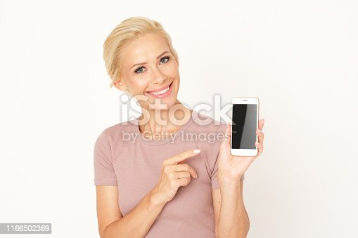 Nice blonde adult woman with phone.