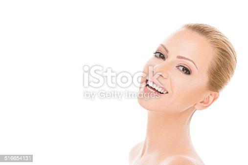 673361134 istock photo Beautiful woman smiling at camera 516654131