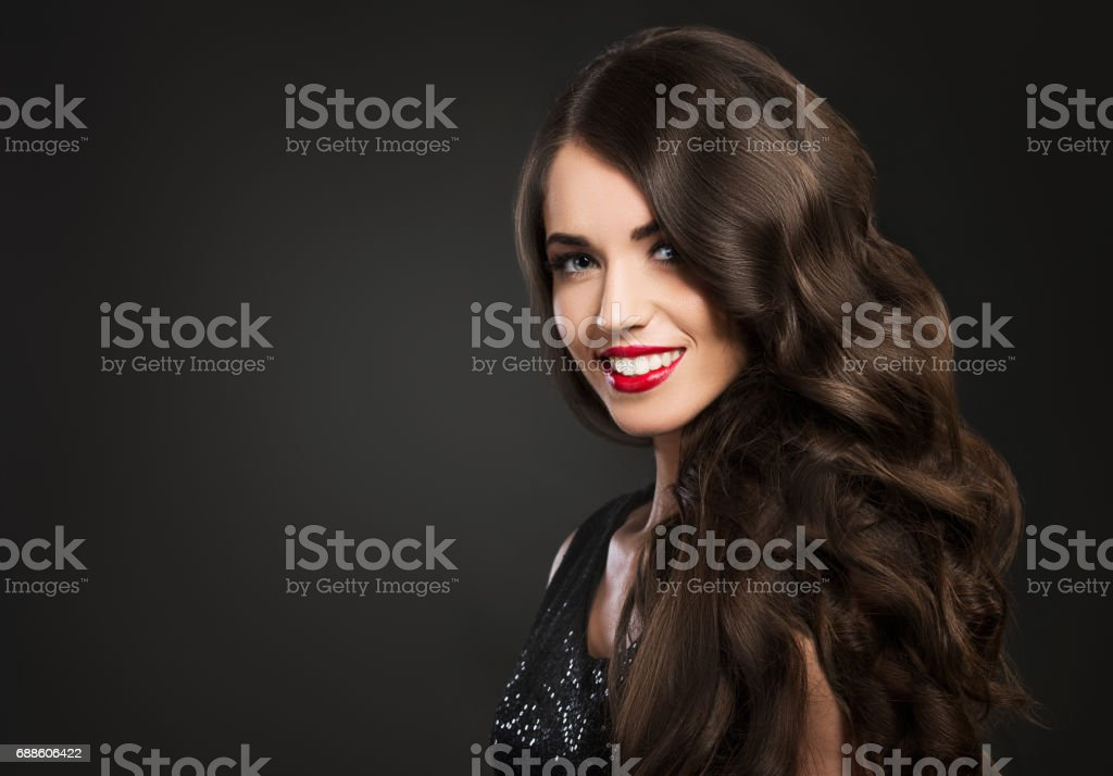 Beautiful woman smiling, glamour portrait on dark background - Photo