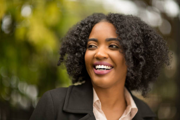 Beautiful woman smiling. Confident African American Woman afro caribbean ethnicity stock pictures, royalty-free photos & images