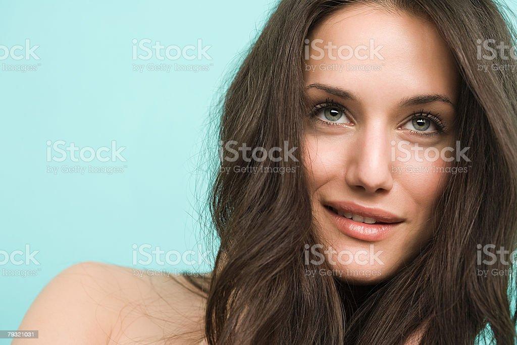 A beautiful woman smirking stock photo