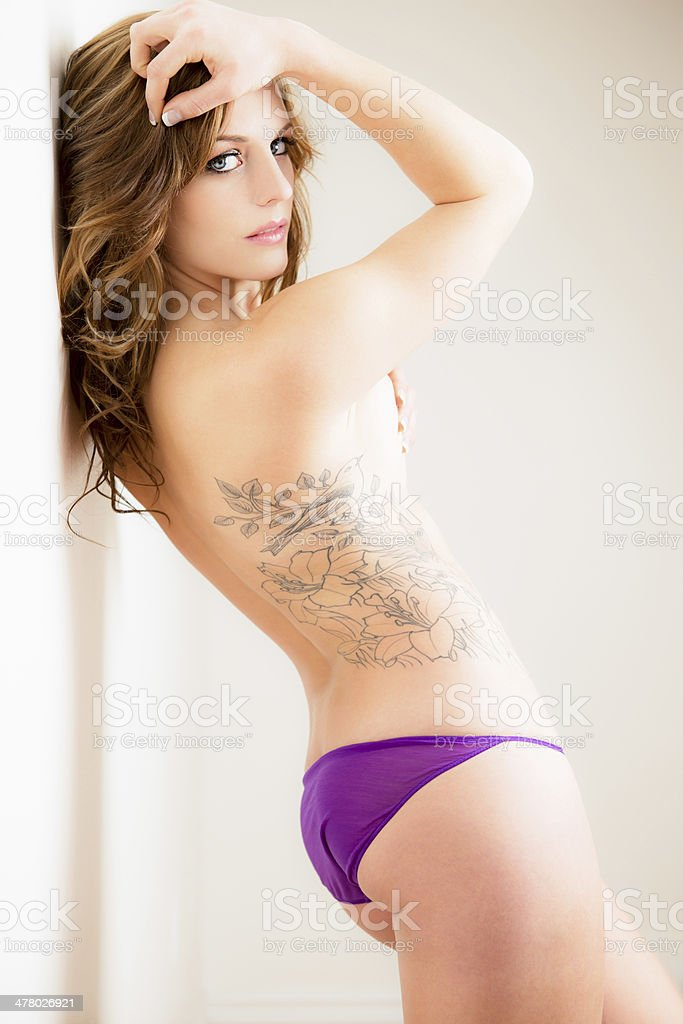 Beautiful woman standing against wall royalty-free stock photo