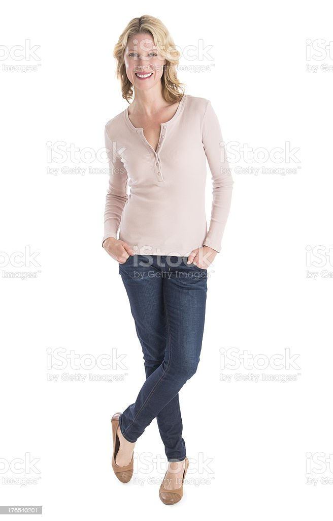 Beautiful Woman Standing Hands In Pockets Over White Background stock photo