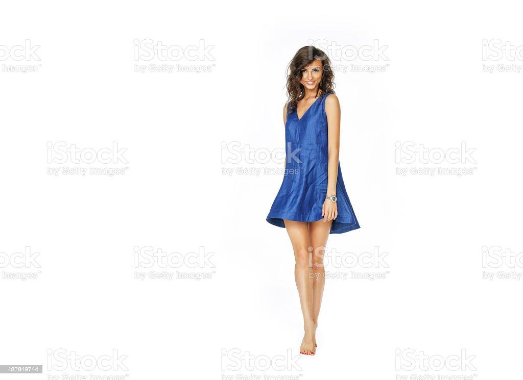 Beautiful woman standing in blue dress stock photo