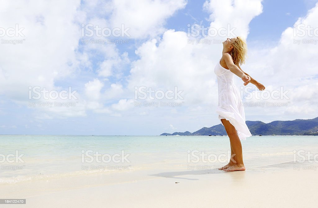 Beautiful woman standing next to the shore looking up. royalty-free stock photo