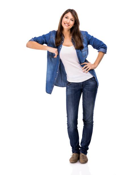 beautiful woman standing over a white background with copyspace for the designer - appoggiarsi foto e immagini stock