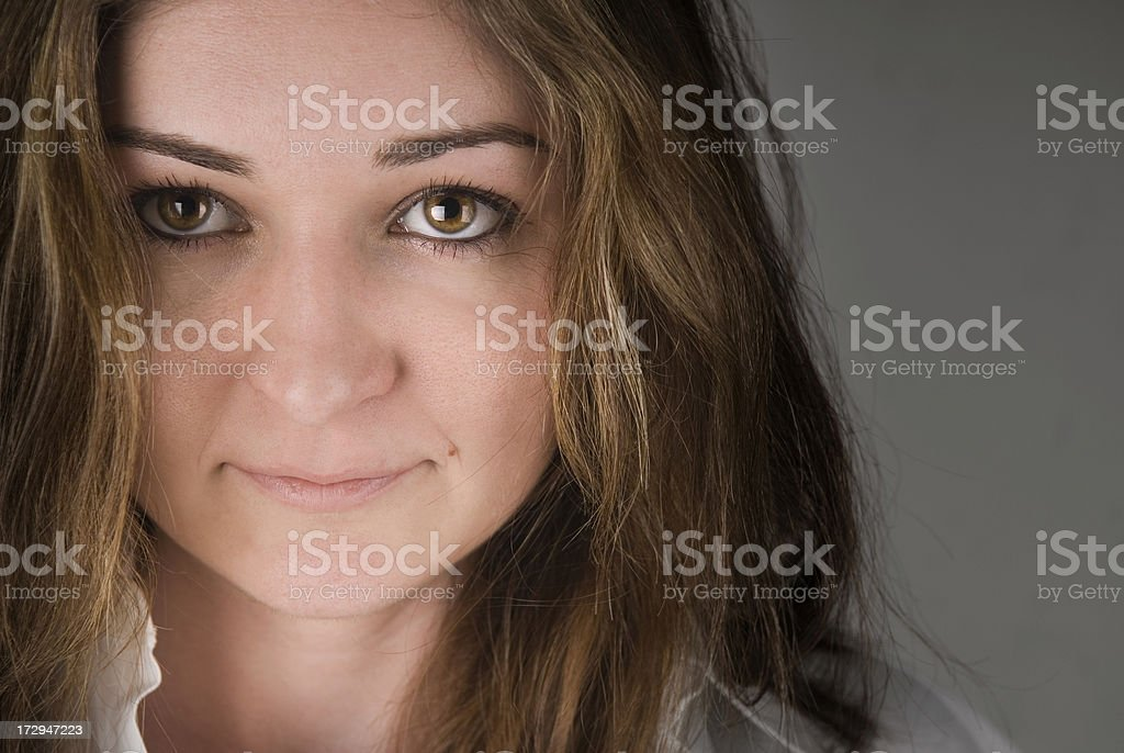 Beautiful Woman Stares into Camera stock photo