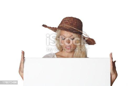 157609352 istock photo Beautiful woman, straw hat, holding a signboard 176072496