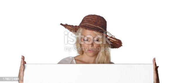 157609352 istock photo Beautiful woman, straw hat, holding a signboard 176072499