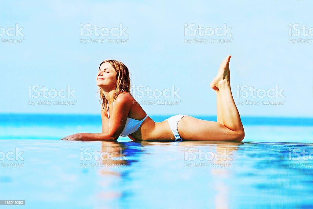 Beautiful woman sunbathing on beach. royalty-free stock photo