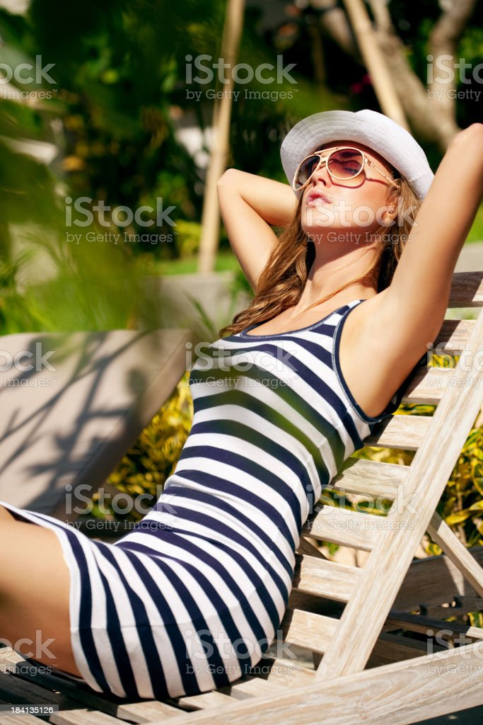 Beautiful woman sunbathing royalty-free stock photo