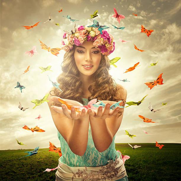 Beautiful woman surrounds many butterfly stock photo