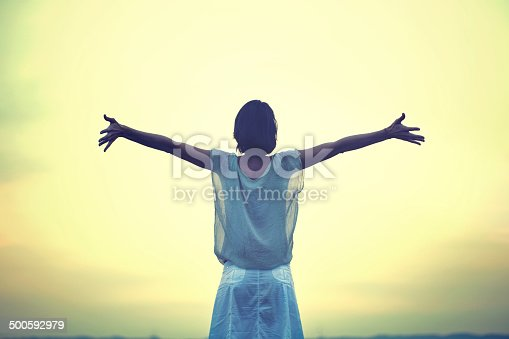 istock beautiful woman taking a deep breath at the sunset 500592979