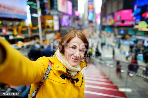 istock Beautiful woman taking a selfie on Times Square 504908092