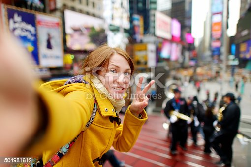 istock Beautiful woman taking a selfie on Times Square 504981612