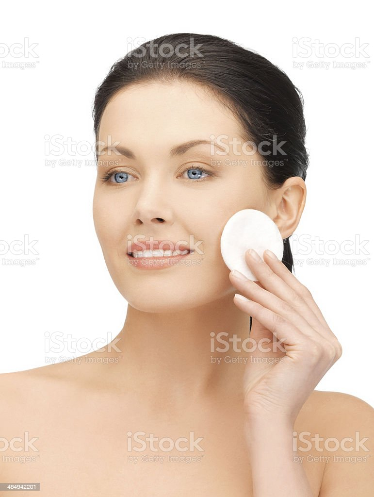 Beautiful woman taking care of her skin with a cotton pad stock photo