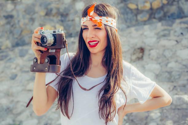Beautiful woman taking photo with old fashioned film camera picture id686034172?b=1&k=6&m=686034172&s=612x612&w=0&h=8nwaz t7pbamxbq93w qtmltjwe17mpwfhxb4xc2yeg=
