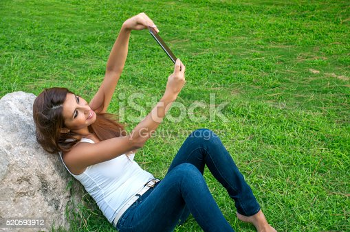 1128981457 istock photo Beautiful woman taking selfies 520593912