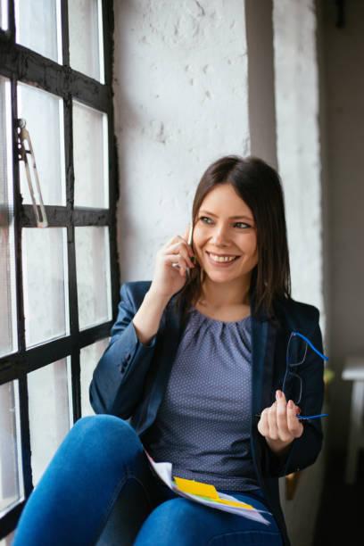 Beautiful woman talking on mobile phone stock photo