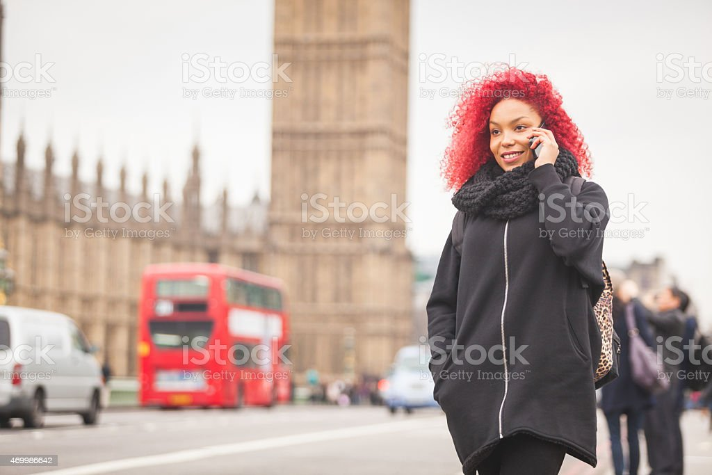 Beautiful woman talking on mobile with Big Ben on background stock photo