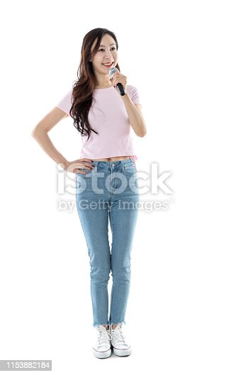 Beautiful woman talking with microphone on white background.