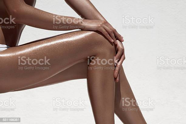 Beautiful woman tan legs against white wall picture id531166051?b=1&k=6&m=531166051&s=612x612&h=qhdocdp0f3a8v3y6i19yxpnfi4rtjdylcd41zl chng=