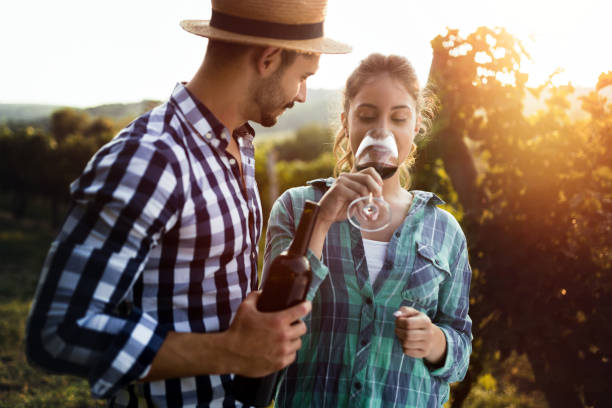 beautiful woman tasting wine in wine grower vineyard - oenologie photos et images de collection