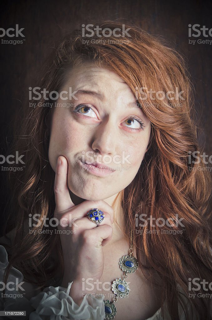 Beautiful Woman Thinking or Daydreaming royalty-free stock photo