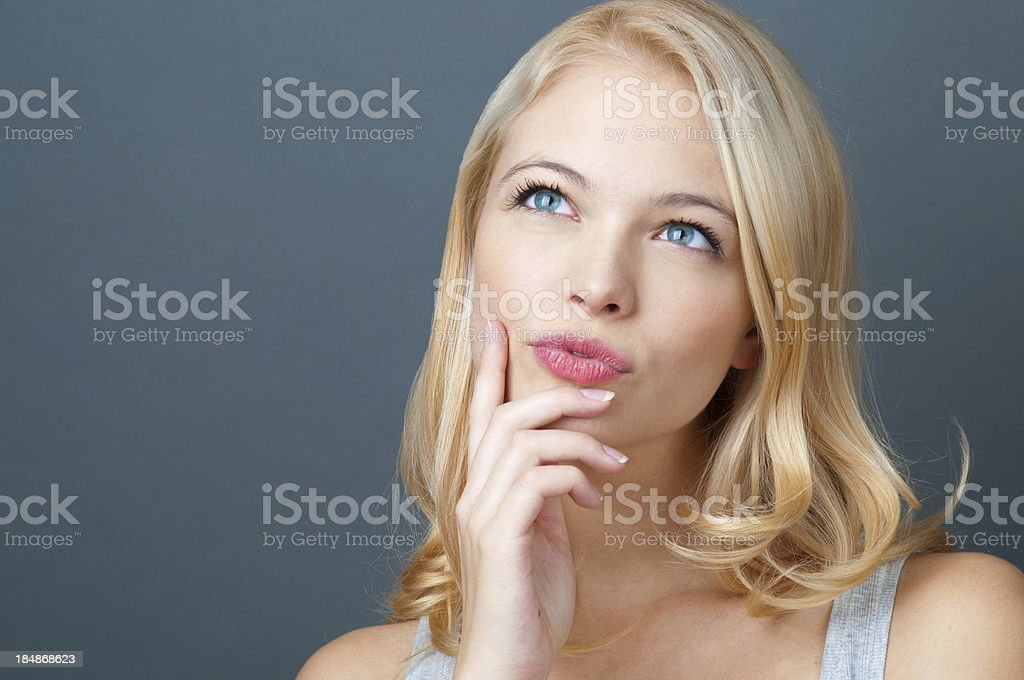 beautiful woman thinking stock photo