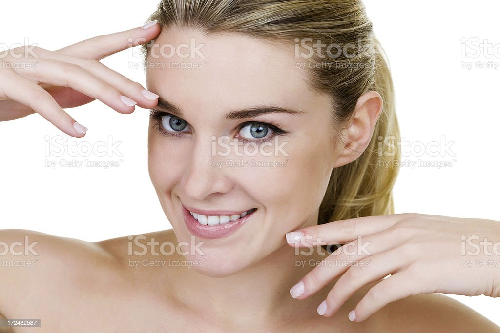 Beautiful woman touching her face royalty-free stock photo