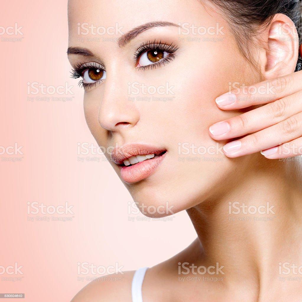 beautiful woman touching skin of  face stock photo