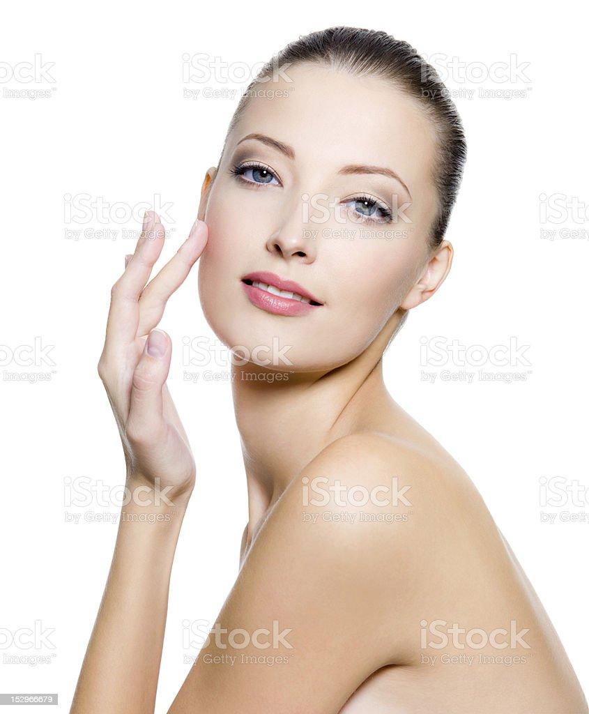 Beautiful woman touching the cheek on face royalty-free stock photo