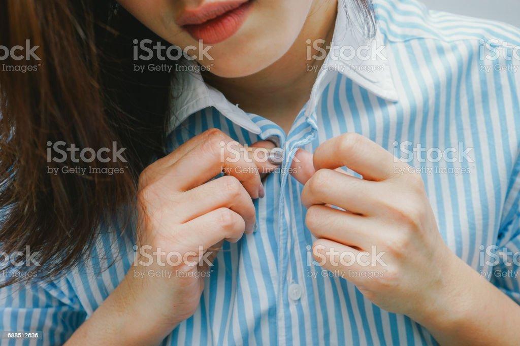 beautiful woman unbuttoning her shirt . stock photo