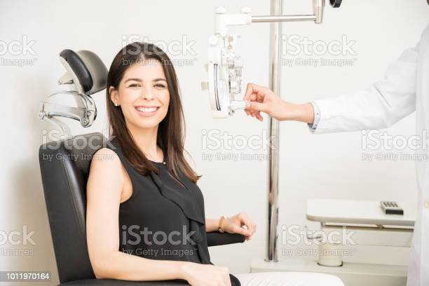 Beautiful woman undergoing eye test with phoropter in optical store picture id1011970164?b=1&k=6&m=1011970164&s=612x612&h=bsnga08ktx3nxq7vllzhpdj oqjcsqb6raqeej2bb88=