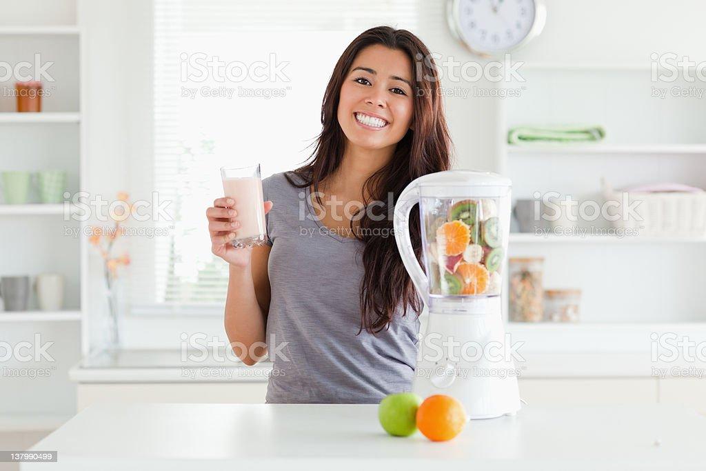 Beautiful woman using a blender stock photo
